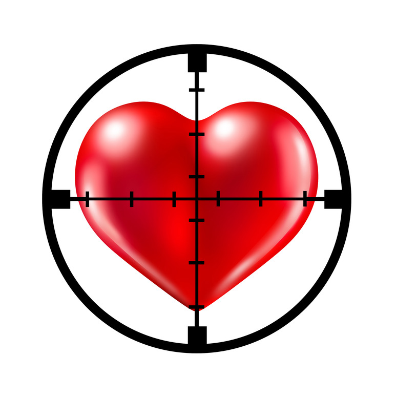 Hunting for love. aiming target at a red heart representing the concept of dating and relationships search and searching for your soul mate.