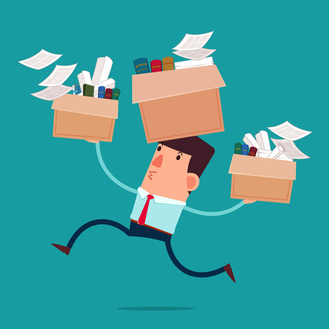 Businessman moving boxes